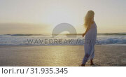 Купить «Woman dancing on the beach 4k», видеоролик № 31935345, снято 12 декабря 2018 г. (c) Wavebreak Media / Фотобанк Лори
