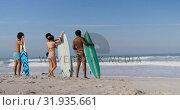 Купить «Group of friends standing with surfboard 4k», видеоролик № 31935661, снято 9 января 2019 г. (c) Wavebreak Media / Фотобанк Лори