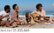 Купить «Group of friends having fun at beach 4k», видеоролик № 31935669, снято 9 января 2019 г. (c) Wavebreak Media / Фотобанк Лори