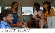 Купить «Friends playing guitar and singing song 4k», видеоролик № 31935677, снято 9 января 2019 г. (c) Wavebreak Media / Фотобанк Лори
