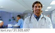 Купить «Male doctor standing in the hospital 4k», видеоролик № 31935697, снято 26 января 2019 г. (c) Wavebreak Media / Фотобанк Лори