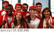 Купить «Sports fans cheering enthusiastically 4k», видеоролик № 31935945, снято 5 апреля 2019 г. (c) Wavebreak Media / Фотобанк Лори
