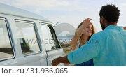Купить «Couple embracing each other near camper van 4k», видеоролик № 31936065, снято 9 января 2019 г. (c) Wavebreak Media / Фотобанк Лори