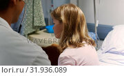 Купить «Male doctor examining girl patient with stethoscope 4k», видеоролик № 31936089, снято 26 января 2019 г. (c) Wavebreak Media / Фотобанк Лори