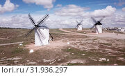 Купить «Scenic view from drone of ancient windmills in Spanish municipality of Campo de Criptana», видеоролик № 31936297, снято 23 апреля 2019 г. (c) Яков Филимонов / Фотобанк Лори