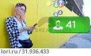 Купить «Woman leaning on a yellow wall browsing on her phone 4k», видеоролик № 31936433, снято 5 апреля 2019 г. (c) Wavebreak Media / Фотобанк Лори