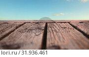 Купить «Wooden deck with a view of the skies», видеоролик № 31936461, снято 5 апреля 2019 г. (c) Wavebreak Media / Фотобанк Лори