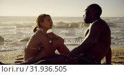 Купить «Couple interacting with each other on the beach 4k», видеоролик № 31936505, снято 24 января 2019 г. (c) Wavebreak Media / Фотобанк Лори