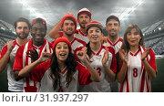 Купить «Group of fans cheering for their team in a stadium», видеоролик № 31937297, снято 27 марта 2019 г. (c) Wavebreak Media / Фотобанк Лори