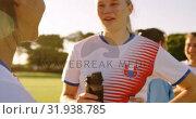 Купить «Female soccer team in break time talking on soccer field. 4k», видеоролик № 31938785, снято 18 апреля 2019 г. (c) Wavebreak Media / Фотобанк Лори