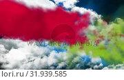 Купить «Green and red smoke in the sky», видеоролик № 31939585, снято 8 мая 2019 г. (c) Wavebreak Media / Фотобанк Лори