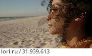 Купить «Woman in sunglasses relaxing on the beach 4k», видеоролик № 31939613, снято 8 февраля 2019 г. (c) Wavebreak Media / Фотобанк Лори