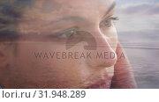 Купить «Woman and the beach», видеоролик № 31948289, снято 8 мая 2019 г. (c) Wavebreak Media / Фотобанк Лори