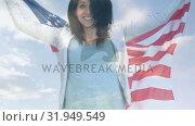 Купить «Woman holding American flag», видеоролик № 31949549, снято 24 мая 2019 г. (c) Wavebreak Media / Фотобанк Лори