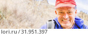 Купить «Laughing adult man in a baseball cap with a backpack.», фото № 31951397, снято 23 апреля 2019 г. (c) Акиньшин Владимир / Фотобанк Лори