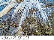 Купить «Long icicles dangle from the rock. Bottom view.», фото № 31951441, снято 23 апреля 2019 г. (c) Акиньшин Владимир / Фотобанк Лори