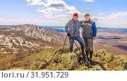 Купить «Two friends are standing on the top of the mountain, enjoying the ascent.», фото № 31951729, снято 25 апреля 2019 г. (c) Акиньшин Владимир / Фотобанк Лори