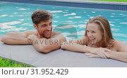 Купить «Couple standing at the edge of swimming pool 4k», видеоролик № 31952429, снято 12 марта 2019 г. (c) Wavebreak Media / Фотобанк Лори