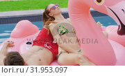 Купить «Couple sleeping together on inflatable tube in swimming pool 4k», видеоролик № 31953097, снято 12 марта 2019 г. (c) Wavebreak Media / Фотобанк Лори