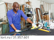 Купить «Young African American glazier during daily work», фото № 31957601, снято 16 мая 2018 г. (c) Яков Филимонов / Фотобанк Лори
