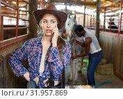 Купить «Woman farmer worker using phone in stable», фото № 31957869, снято 2 октября 2018 г. (c) Яков Филимонов / Фотобанк Лори