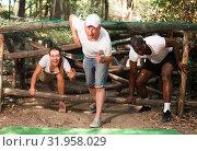 Купить «Emotional competition to overcome obstacle course in an amusement park», фото № 31958029, снято 3 июня 2020 г. (c) Яков Филимонов / Фотобанк Лори