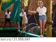 Купить «Obstacle course over the water - fun adventure in an amusement park», фото № 31958041, снято 18 сентября 2019 г. (c) Яков Филимонов / Фотобанк Лори