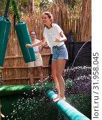 Купить «Obstacle course over the water - fun adventure in an amusement park», фото № 31958045, снято 18 сентября 2019 г. (c) Яков Филимонов / Фотобанк Лори