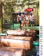 Купить «Two teams compete on an obstacle course in an amusement park.», фото № 31958049, снято 25 августа 2019 г. (c) Яков Филимонов / Фотобанк Лори