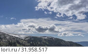 Купить «Time lapse of cloudscape behind of the mountains top. Snow, rocks, cliffs and deep blue sky. High altitude.», видеоролик № 31958517, снято 20 июля 2019 г. (c) Александр Маркин / Фотобанк Лори