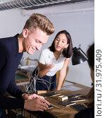 Купить «Architect with team creating architectural model», фото № 31975409, снято 8 ноября 2018 г. (c) Яков Филимонов / Фотобанк Лори