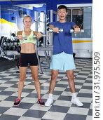 Купить «Couple during weightlifting workout», фото № 31975509, снято 16 июля 2018 г. (c) Яков Филимонов / Фотобанк Лори