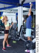 Купить «Couple during weightlifting workout», фото № 31975521, снято 16 июля 2018 г. (c) Яков Филимонов / Фотобанк Лори