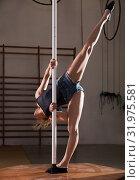 Купить «Young woman in denim shorts practicing pole dancing», фото № 31975581, снято 9 декабря 2019 г. (c) Яков Филимонов / Фотобанк Лори