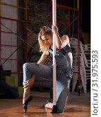 Купить «Beautiful slim girl with pylon. Female pole dancer woman dancing on a pole», фото № 31975593, снято 15 сентября 2019 г. (c) Яков Филимонов / Фотобанк Лори