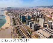 Купить «Barcelona, Spain - March 05, 2019: Modern high-rise buildings in the coastal residential areas of Diagonal Mar and Poblenou», фото № 31975617, снято 5 марта 2019 г. (c) Яков Филимонов / Фотобанк Лори