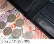 Купить «Российские рубли лежат рядом с кошельком», фото № 31975905, снято 3 августа 2019 г. (c) Екатерина Овсянникова / Фотобанк Лори