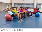 Купить «Female trainer training people to perform yoga on exercise ball», фото № 31984813, снято 24 марта 2019 г. (c) Wavebreak Media / Фотобанк Лори