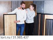 Купить «couple looking laminated flooring», фото № 31985437, снято 2 февраля 2018 г. (c) Яков Филимонов / Фотобанк Лори