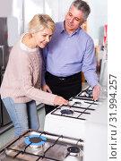 Купить «Smiling mature couple are buying in center of household applianc», фото № 31994257, снято 13 июля 2020 г. (c) Яков Филимонов / Фотобанк Лори