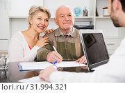 Купить «Old man and woman in social department», фото № 31994321, снято 3 августа 2020 г. (c) Яков Филимонов / Фотобанк Лори