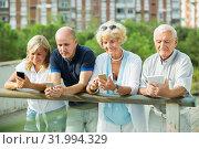 Купить «elderly people chatting in phones», фото № 31994329, снято 24 августа 2017 г. (c) Яков Филимонов / Фотобанк Лори