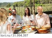 Купить «Adults enjoying dinner outdoor», фото № 31994397, снято 11 апреля 2019 г. (c) Яков Филимонов / Фотобанк Лори