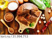 Купить «Zucchini cake with cocoa powder», фото № 31994713, снято 3 июля 2019 г. (c) Надежда Мишкова / Фотобанк Лори