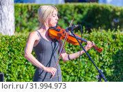 Купить «Russia, Samara, June 2019. Young violinist playing in the park.», фото № 31994973, снято 9 июня 2019 г. (c) Акиньшин Владимир / Фотобанк Лори