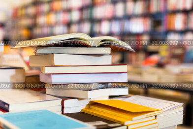 stack of books lying on table in bookstore