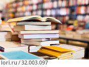 stack of books lying on table in bookstore. Стоковое фото, фотограф Татьяна Яцевич / Фотобанк Лори