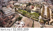 Купить «Aerial panoramic view of Jerez de la Frontera cityscape with Cathedral of Holy Saviour and Moorish alcazar, Spain», видеоролик № 32003209, снято 19 апреля 2019 г. (c) Яков Филимонов / Фотобанк Лори