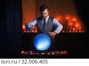 man fortune teller with illuminated crystal ball. Стоковое фото, фотограф Майя Крученкова / Фотобанк Лори