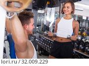 Купить «Woman making biceps curls», фото № 32009229, снято 13 декабря 2019 г. (c) Яков Филимонов / Фотобанк Лори